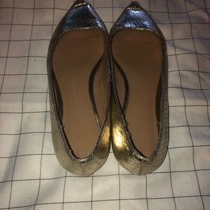 Gold pointy flats